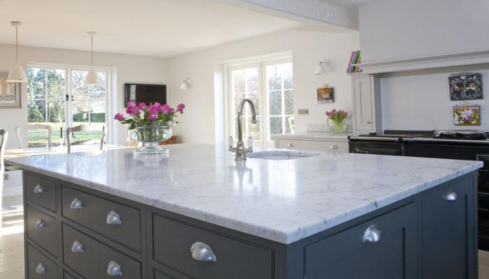 Beautiful honed cararra marble worktop has been used in the light and ...